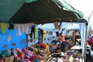 An organized chaos of clothes to be handed out to those in need.