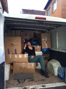 After packing the van halfway, Pamela stops to pose for a picture.